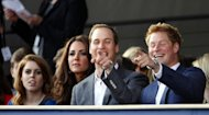 Britain's Princess Beatrice, (L) Catherine Duchess of Cambridge (2nd L) Prince William (2nd R) and Prince Harry (R) enjoy the Diamond Jubilee Concert. Queen Elizabeth II smiled as she took her place for the concert Monday, despite her husband's sudden hospitalisation