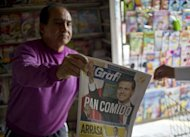 &lt;p&gt;A man sells a newspaper with information on the new Mexican president for the Institutional Revolutionary Party (PRI), Enrique Pena Nieto. The PRI was synonymous with the Mexican state as it governed for seven decades until 2000 using a mixture of pervasive patronage, selective repression, rigged elections and widespread bribery.&lt;/p&gt;