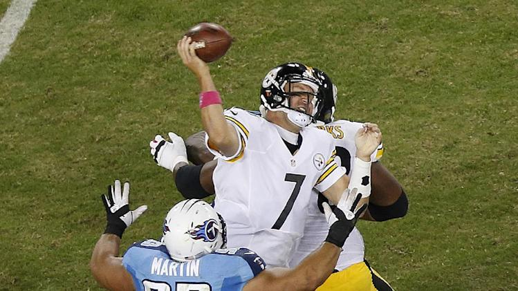 Pittsburgh Steelers quarterback Ben Roethlisberger (7) fumbles as he is sacked by Tennessee Titans defensive tackle Mike Martin (93) during the second half of an NFL football game Thursday, Oct. 11, 2012, in Nashville, Tenn. Tennessee recovered the ball. (AP Photo/Joe Howell)