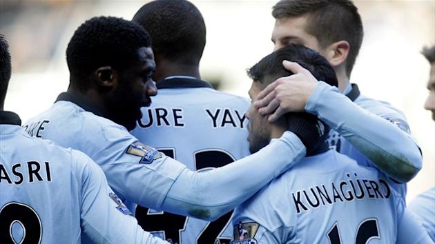 Kolo Toure congratulates Sergio Aguero (AFP)