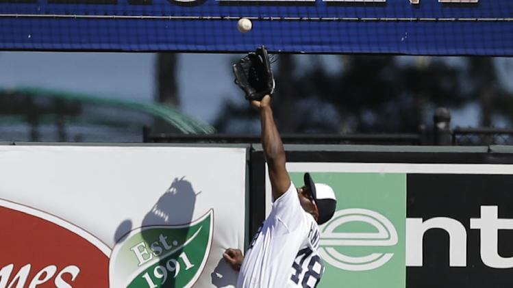Detroit Tigers right fielder Torii Hunter robs New York Mets' Andrew Brown of a home run during the fourth inning of a spring training baseball game in Lakeland, Fla., Saturday, March 8, 2014