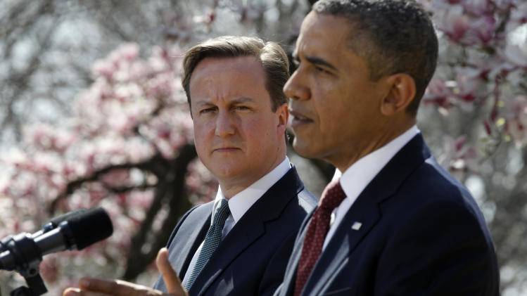 President Barack Obama and British Prime Minister David Cameron take part in a joint news conference in the Rose Garden of the White House in Washington, Wednesday, March 14, 2012. (AP Photo/Charles Dharapak)
