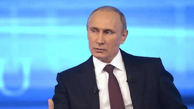 "Russian President Vladimir Putin speaks during a nationally televised question-and-answer session in Moscow on Thursday, April 17, 2014. Russia's President Vladimir Putin on Thursday dismissed claims that Russian special forces are fomenting unrest in eastern Ukraine as ""nonsense,"" but voiced hope for success of four-way talks on settling the crisis. (AP Photo/RIA Novosti, Alexei Nikolsky, Presidential Press Service)"