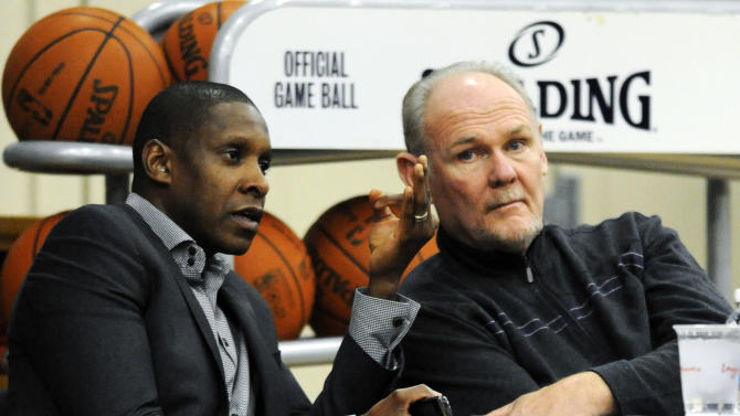 FILE - In this Dec. 9, 2011, file photo, Denver Nuggets executive vice president of basketball operations Masai Ujiri, left, talks with head coach George Karl during the first day of NBA basketball training camp in Denver. Ujiri was named the NBA's executive of the year on Thursday, May 9, 2013, a day after Karl was named the league's top coach. (AP Photo/Jack Dempsey, File)