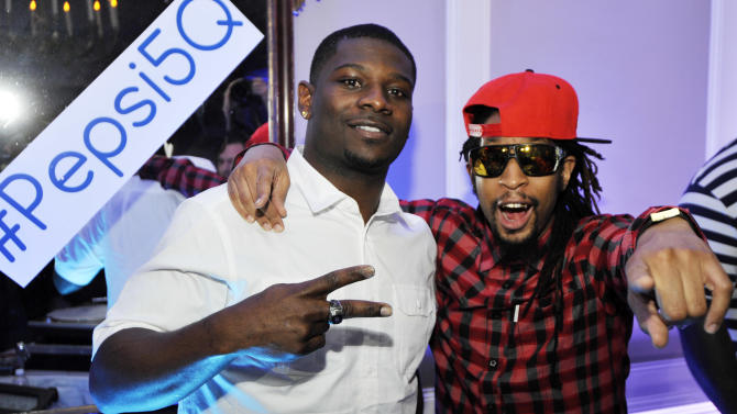 IMAGE DISTRIBUTED FOR PEPSI - Former NFL running back LaDainian Tomlinson, left, poses with Lil Jon at the Pepsi 5th Quarter in the French Quarter Post Super Bowl Party, on Sunday, Feb. 3, 2013, in New Orleans. (Photo by Jack Dempsey/Invision for Pepsi/AP Images)