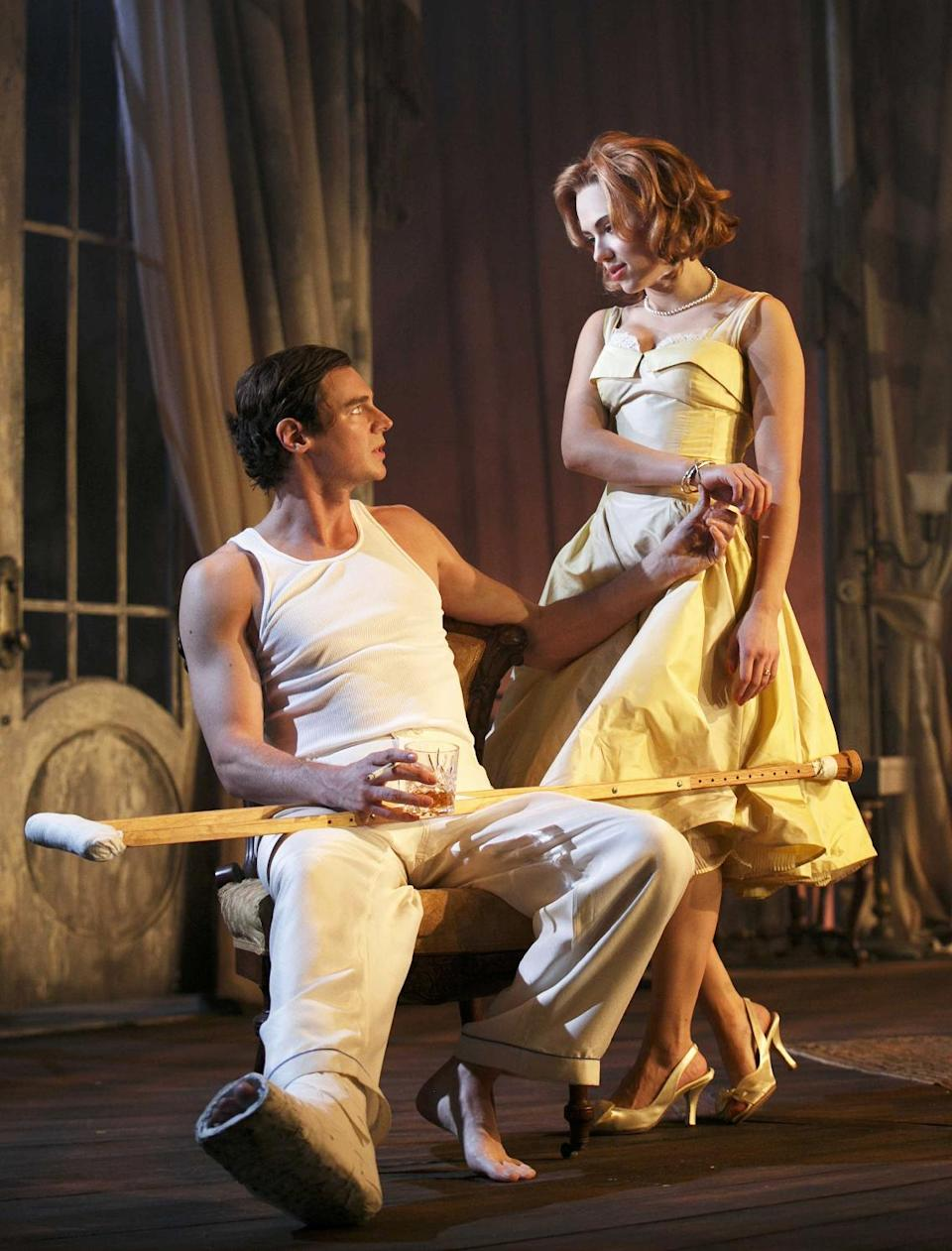 "This undated theater image released by Boneau/Bryan-Brown showsBenjamin Walker, left, and  Scarlett Johansson during a performance of ""Cat on a Hot Tin Roof,"" playing at the Richard Rodgers Theatre in New York. (AP Photo/Boneau/Bryan-Brown, Joan Marcus)"