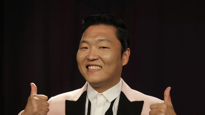"""This Aug. 22, 2012 photo shows South Korean rapper PSY posing for a photo in New York. His """"Gangnam Style"""" video has more than 200 million YouTube views and counting, and it's easy to see why. Gangnam is only a small slice of Seoul, but it inspires a complicated mixture of desire, envy and bitterness. It's also the spark for PSY's catchy, world-conquering song. (AP Photo/John Carucci)"""