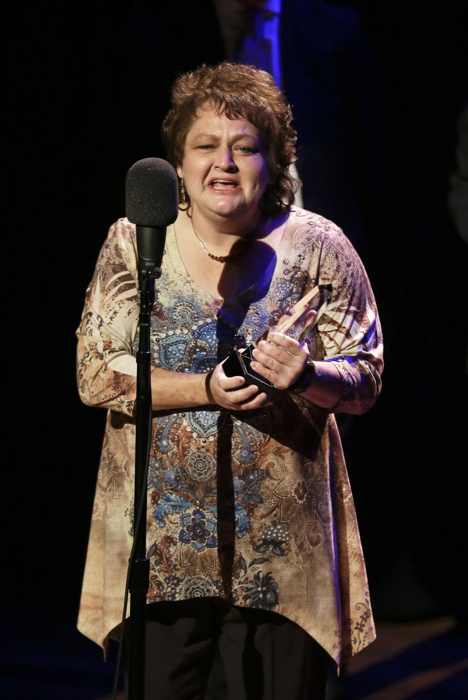 Dale Ann Bradley accepts the female vocalist of the year award at the International Bluegrass Music Association Awards show on Thursday, Sept. 27, 2012, in Nashville, Tenn. (AP Photo/Mark Humphrey)
