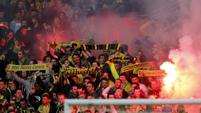 Supporters of FC Nantes light flares during their French Ligue 1 soccer match against Paris St Germain at the Beaujoire stadium in Nantes