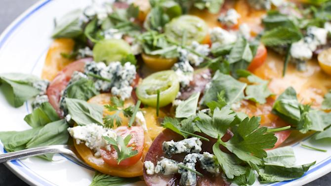 In this image taken on June 10, 2013, an American tomato salad is shown served on a platter in Concord, N.H. (AP Photo/Matthew Mead)