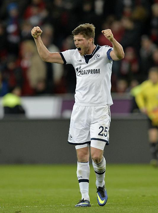 Schalke's Klaas-Jan Huntelaar of the Netherlands celebrates after winning the German Bundesliga soccer match between Bayer Leverkusen and FC Schalke 04 in Leverkusen,  Germany, Saturday, Feb. 15,
