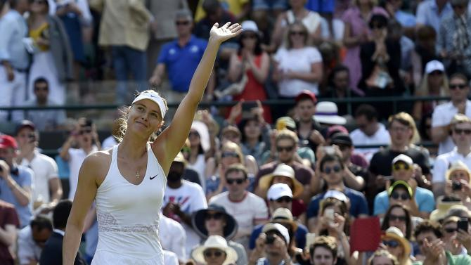Maria Sharapova of Russia celebrates after winning her match against Irina-Camelia Begu of Romania at the Wimbledon Tennis Championships in London