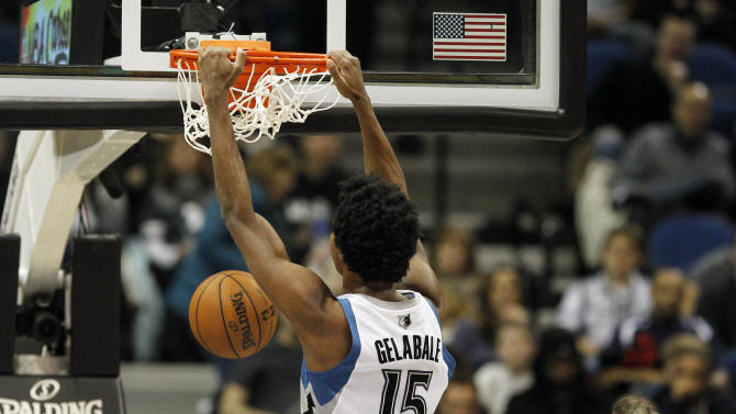 Minnesota Timberwolves forward Mickael Gelabale (15) dunks the ball against the San Antonio Spurs during the first half of an NBA basketball game Wednesday, Feb. 6, 2013 in Minneapolis. (AP Photo/Genevieve Ross)