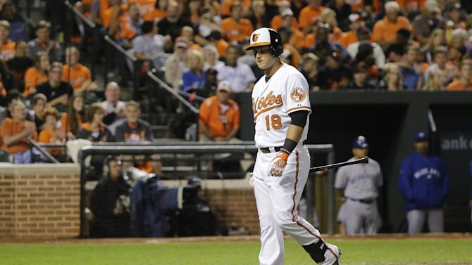Baltimore Orioles' Christian Walker walks off the field after striking out in his first Orioles at-bat in a baseball game against the Toronto Blue Jays, Wednesday, Sept. 17, 2014, in Baltimore. (AP Photo/Patrick Semansky)