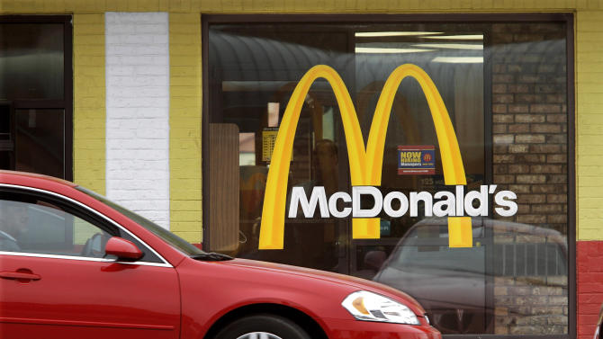 FILE - This Oct. 17, 2011 file photo shows the McDonald's logo on a McDonald's drive through window, in Springfield, Ill. McDonald's Corp. announced Monday, Oct. 24, 2011, that the boneless barbecue pork sandwich, usually available in only a few stores at a time, will be sold at all U.S. locations through Nov. 14. (AP Photo/Seth Perlman, File)