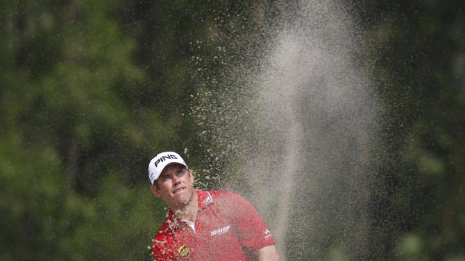 Lee Westwood from England watches the ball on the 9th hole during the HSBC Champions golf tournament in Dongguan, southern China's Guangdong province, Sunday Nov. 4, 2012. (AP Photo/Kin Cheung)