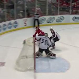 Niklas Kronwall chips it up high past Giguere