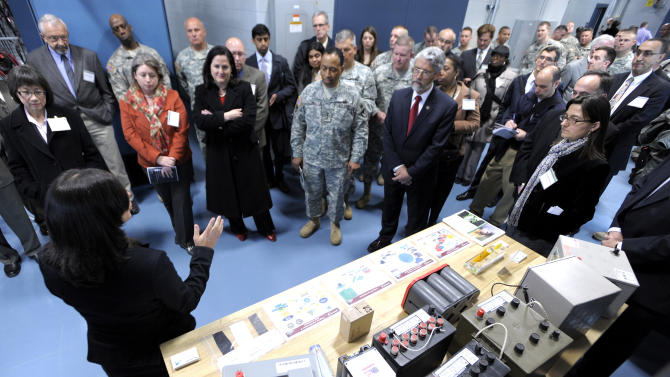 Electric engineer energy storage team leader Sonya Zanardelli, left, talks about the Energy Storage Lab where all types of batteries are tested for performance and durability, Wednesday, April 11, 2012 in Warren, Mich. The U.S. Army unveiled a new laboratory Wednesday that can simulate Afghanistan's desert heat and Antarctica's extreme cold in an effort to discover how to save energy and make combat vehicles fuel-efficient. (AP Photo/Detroit News, Todd McInturf )  DETROIT FREE PRESS OUT; HUFFINGTON POST OUT