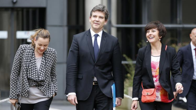 French Economy Minister Arnaud Montebourg and junior minister for Digital Economy Axelle Lemaire arrive to attend a conference about the economic recovery of France at the Bercy ministry in Paris