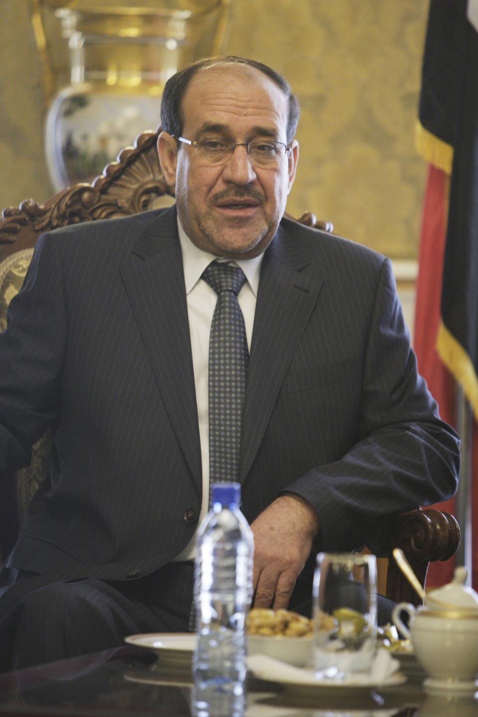 Iraqi Prime Minister Nouri al-Maliki talks with Iranian Vice-President Mohammad Reza Rahimi, unseen, after his official arrival ceremony in Tehran, Iran, Sunday, April 22, 2012. (AP Photo/Vahid Salemi)
