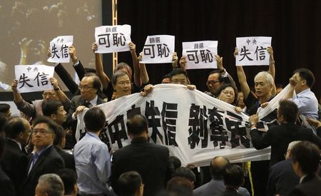 Hong Kong pro-democracy activists heckle China official day after vote ruling