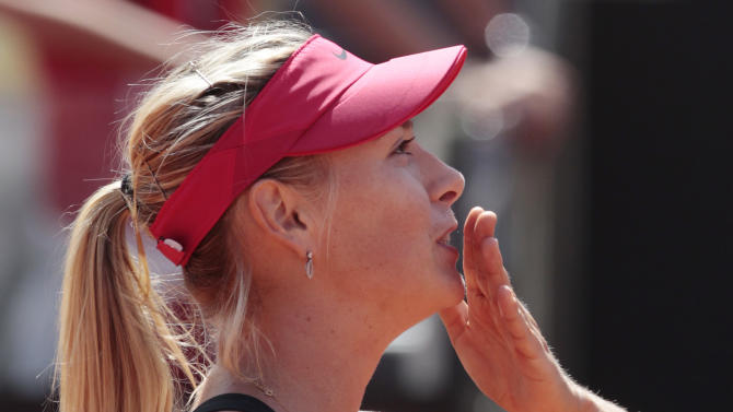 Russia's Maria Sharapova celebrates after winning her semifinal match against Germany's Angelique Kerber at the Italian Open tennis tournament, in Rome, Saturday, May 19, 2012. (AP Photo/Gregorio Borgia)