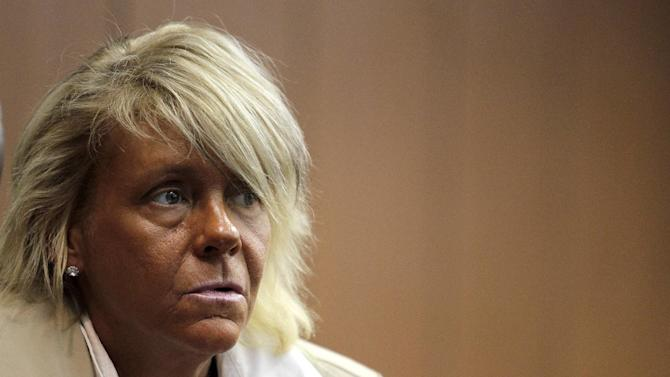 "FILE - In this May 2, 2012 file photo, Patricia Krentcil, 44, waits to be arraigned at the Essex County Superior Court in Newark, N.J., where she appeared on charges of endangering her 5-year-old child by taking her into a tanning salon. A grand jury in New Jersey has decided to let Krentcil a woman who gained overnight notoriety as ""the tanning mom"" bronze away in peace. Prosecutors in Newark said Tuesday, Feb. 26, 2013 a grand jury refused to indict Patricia Krentcil on a charge she took her young daughter into a tanning booth with her. (AP Photo/Julio Cortez, File)"