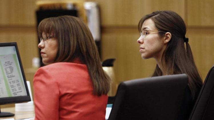 Defense attorney Jennifer Wilmott and defendant Jodi Arias, right, listens to lead defense attorney Kirk Nurmi make his closing arguments during her trial Friday, May 3, 2013 at Maricopa County Superior Court in Phoenix.  Arias is charged with first-degree murder in the stabbing and shooting death of Travis Alexander, 30, in his suburban Phoenix home in June 2008. (AP Photo/The Arizona Republic, Rob Schumacher, Pool)
