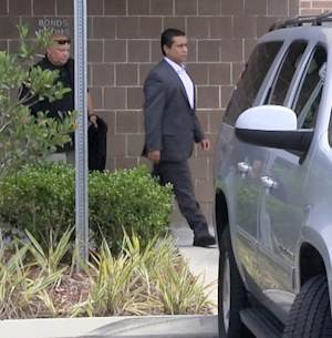 """In this  still image taken from video, George Zimmerman leaves the Seminole County Jail after posting bail, Friday, July 6, 2012, in Sanford, Fla. Zimmerman left the Seminole County Jail a day after Circuit Judge Kenneth Lester granted a $1 million bail with strict conditions. The neighborhood watch leader is required to stay in Seminole County. Zimmerman has pleaded not guilty to second-degree murder and claims the shooting was self-defense under the state's """"stand your ground"""" law. (AP Photo/Mike Lewis)"""