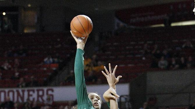 Baylor forward Brittney Griner, back, shoots over Oklahoma forward Joana McFarland and Aaryn Ellenberg during the first half of a NCAA Women's basketball game in Norman, Monday, Feb. 25, 2013.  (AP Photo/Alonzo Adams)