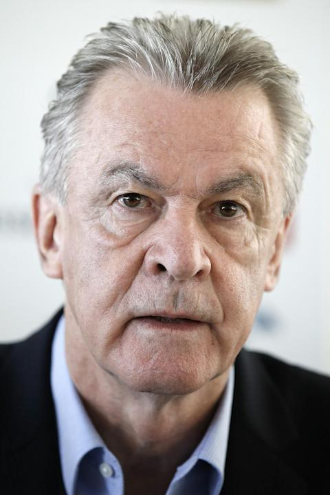 Switzerland's head coach Ottmar Hitzfeld attends a news conference in Bern, Switzerland, Thursday, Oct. 17, 2013, where he announced that he will leave his job after the soccer World Cup in Brazil. Hi