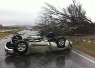 &lt;p&gt;               A vehicle lies on a road after a tornado moved through Adairsville, Ga. on Wednesday, Jan. 30, 2013. A fierce storm system that roared across northwest Georgia has left at least one person dead and a trail of damage that included demolished buildings in downtown Adairsville and vehicles overturned on Interstate 75 northwest of Atlanta. (AP Photo/David Goldman)