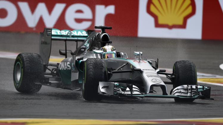Mercedes Formula One driver Hamilton of England drives the track during the qualification session at the Belgian F1 Grand Prix in Spa-Francorchamps