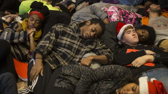 Protesters, demanding justice for the killing of 18-year-old Michael Brown, interrupt Black Friday shopping by staging a lie-in at the St. Louis Galleria Mall in Missouri