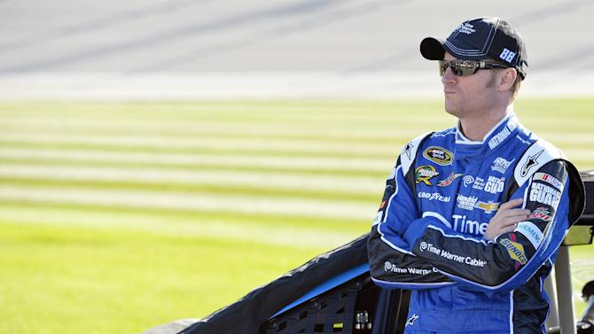 Dale Earnhardt Jr. looks on before qualifying for the NASCAR Sprint Cup Series auto race at Chicagoland Speedway in Joliet, Ill., Friday, Sept. 13, 2013. (AP Photo/Nam Y. Huh)