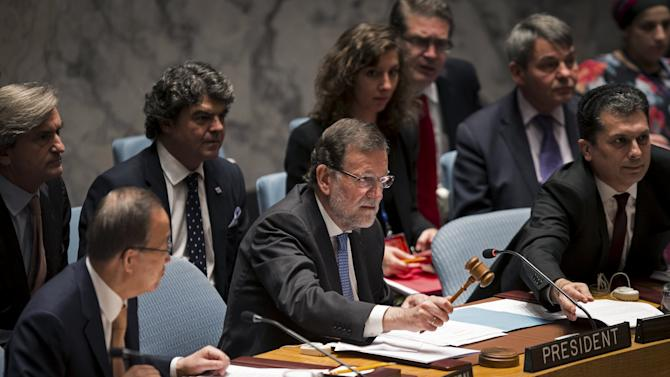 Spanish Prime Minister Rajoy uses a gavel to open a meeting of the United Nations Security Council in New York