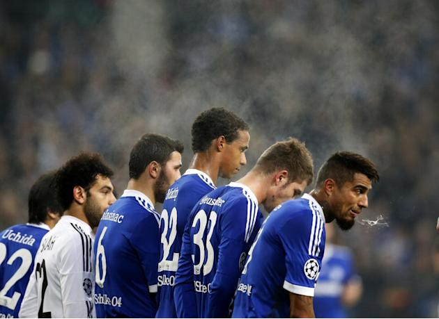 Schalke players wait for a free kick during the Champions League group E soccer match between FC Schalke 04 and FC Basel in Gelsenkirchen, Germany, Wednesday, Dec.11,2013