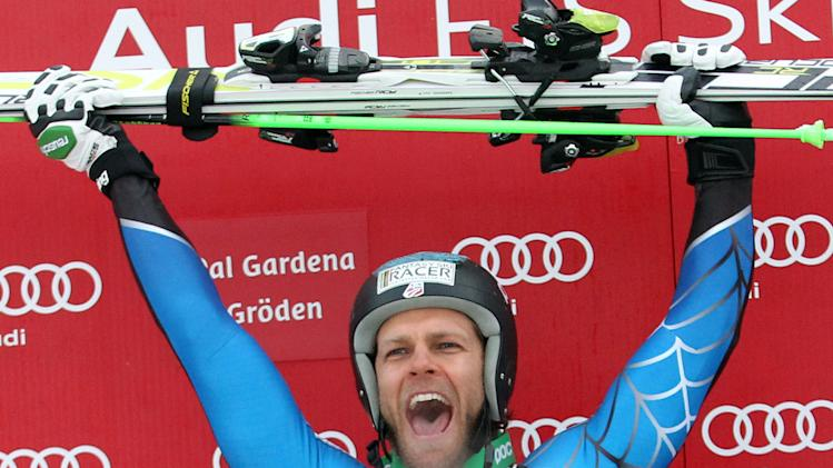 Steven Nyman, of the United States, celebrates on the podium after winning an alpine ski, men's World Cup downhill, in Val Gardena, Italy, Saturday, Dec. 15, 2012. (AP Photo/Alessandro Trovati)