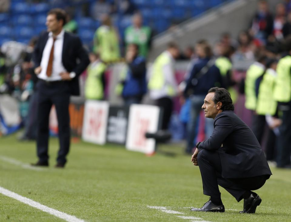 Italy coach Cesare Prandelli watches his team during the Euro 2012 soccer championship Group C match between Italy and Croatia in Poznan, Poland, Thursday, June 14, 2012. In the back is Croatia head coach Slaven Bilic. (AP Photo/Jon Super)