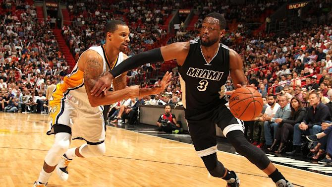Heat escape in final moments, top Pacers 89-87; Deng has 23