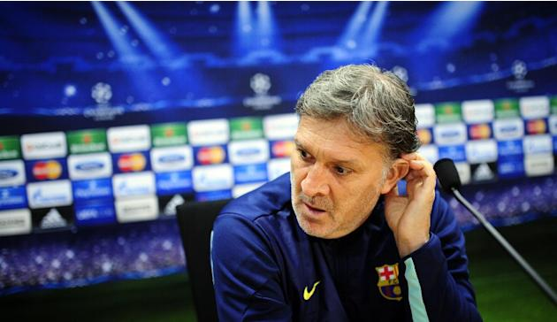FC Barcelona's coach Gerardo Tata Martino, from Argentina, attends a press conference at the Sports Center FC Barcelona Joan Gamper in San Joan Despi, Spain, Tuesday, Dec. 10, 2013. FC Barcelona w