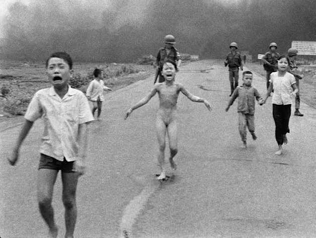 FILE - In this June 8, 1972 file photo, crying children, including 9-year-old Kim Phuc, center, run down Route 1 near Trang Bang, Vietnam after an aerial napalm attack on suspected Viet Cong hiding pl