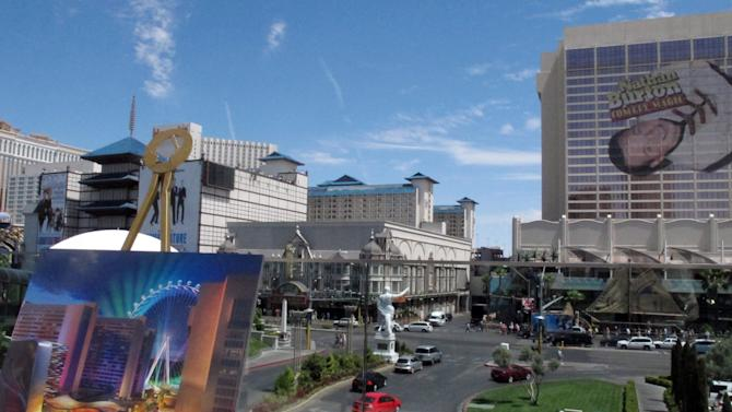 An artist's rendering, lower left, of the Caesars Entertainment Corp.'s $550 million Linq project is displayed in Las Vegas on Wednesday, Aug. 17, 2011, across the street from where the project will be built. Caesars Entertainment Corp. plans to open the outdoor promenade on the Las Vegas Strip in June 2013, linking its casinos on the east side of the boulevard with restaurants, bars and a 550-foot (167-meter) observation wheel. (AP Photo/Oskar Garcia)