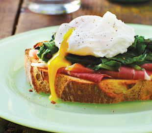 Poached eggs over sautéed spinach