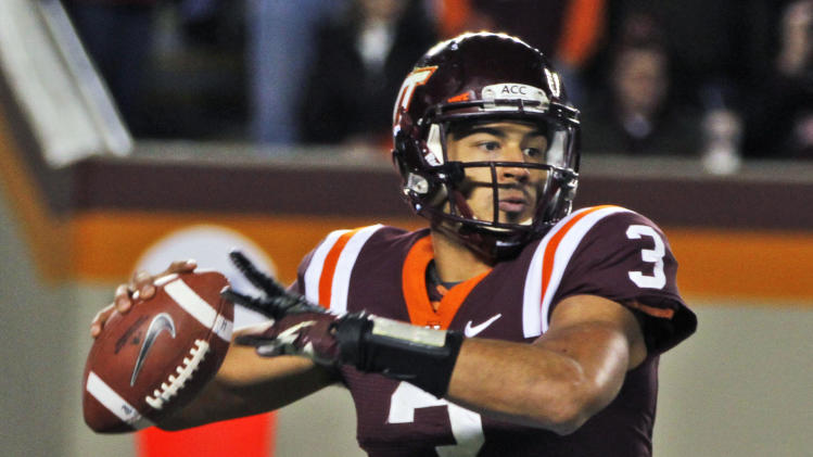 Virginia Tech quarterback Logan Thomas looks for a receiver during the first half of an NCAA college football game against Florida State in Blacksburg, Va., Thursday, Nov. 8, 2012. (AP Photo/Steve Helber)