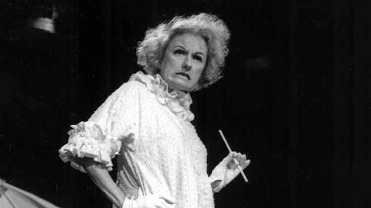 FILE-In this undated file photo, Comedian Phyllis Diller performs in character. Diller, the housewife turned humorist who aimed some of her sharpest barbs at herself, died Monday, Aug. 20, 2012, at age 95 in Los Angeles. (AP Photo/NBC-TV, File)