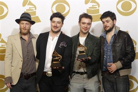 "Mumford & Sons pose with their awards for Album of the Year for ""Babel"" and Best Long Form Music Video for ""Big Easy Express"" backstage at the 55th annual Grammy Awards in Los Angeles, California February 10, 2013. REUTERS/Mario Anzuoni"