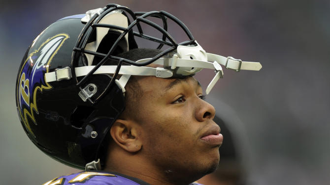 Baltimore Ravens running back Ray Rice looks up at the scoreboard during the first half of an NFL football game against the Denver Broncos in Baltimore, Sunday, Dec. 16, 2012. (AP Photo/Nick Wass)