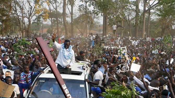 Uganda's main opposition presidential candidate Besigye of the FDC waves to his supporters as he arrives for campaign rally in Lira town, Uganda