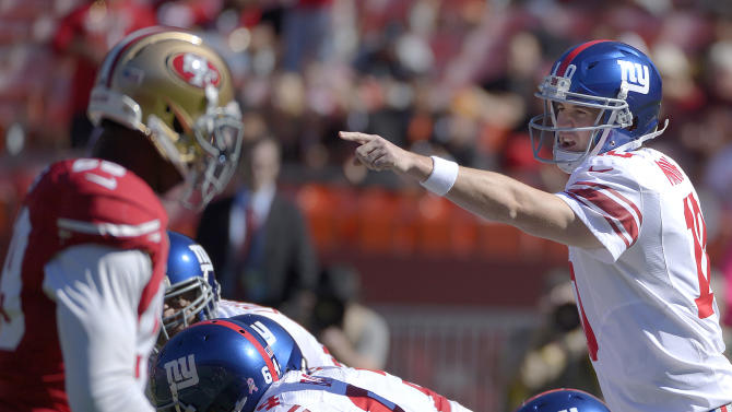 New York Giants quarterback Eli Manning (10) calls a play at the line of scrimmage against the San Francisco 49ers during the first quarter of an NFL football game in San Francisco, Sunday, Oct. 14, 2012. (AP Photo/Mark J. Terrill)